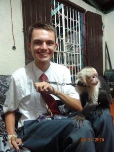 my new friend. This is the first pet monkey I've seen. It is a pet of a member. Not a lot of people have pets here besides dogs, cats and parrots.